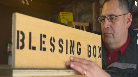 Roman Espinoza assembles a new blessing box in his Watertown, New York workshop.
