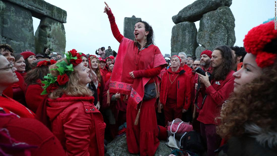People gather at Stonehenge in Wiltshire, England, on December 22 to celebrate the winter solstice and to witness the sunrise after the longest night of the year.