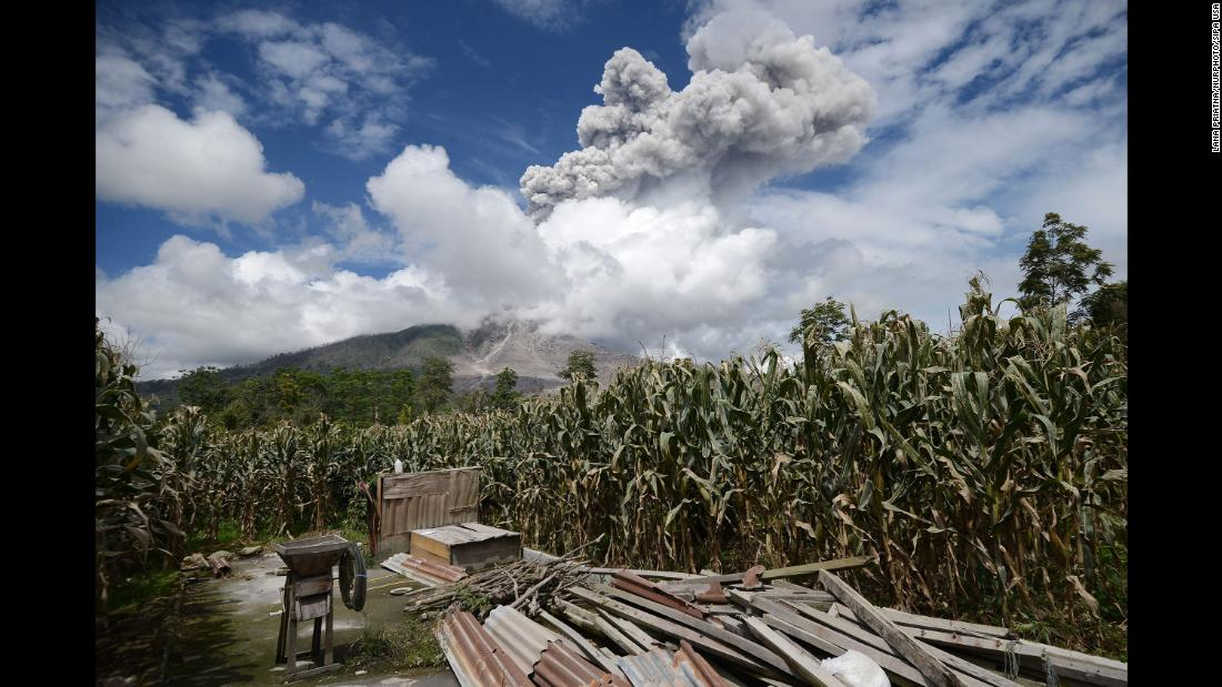 The volcano Sinabung emits an avalanche of hot clouds in Karo, Indonesia, on December 27.