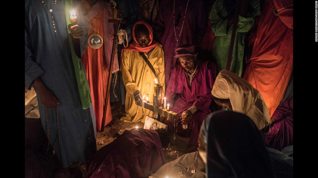 Members of Legio Maria of African Church Mission hold candles during their overnight Christmas Mass at a church near Ugunja, Kenya, early December 25.
