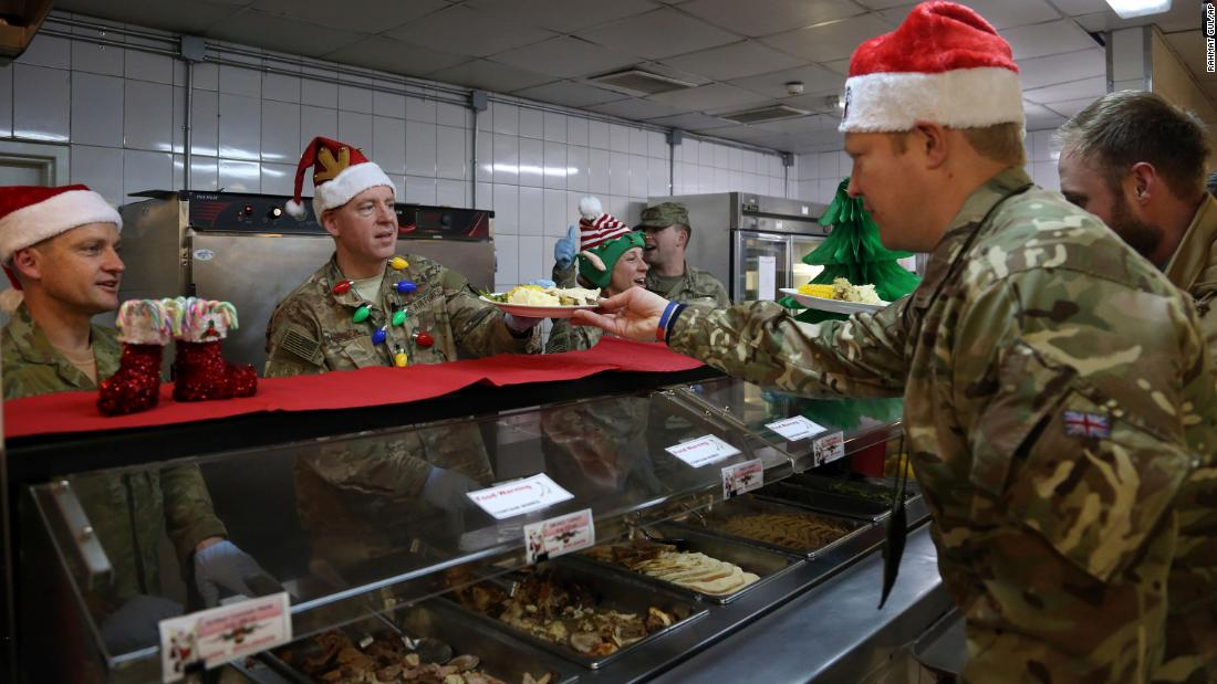 Members of the US military are served dinner on Christmas Day at the Resolute Support Headquarters in Kabul, Afghanistan.