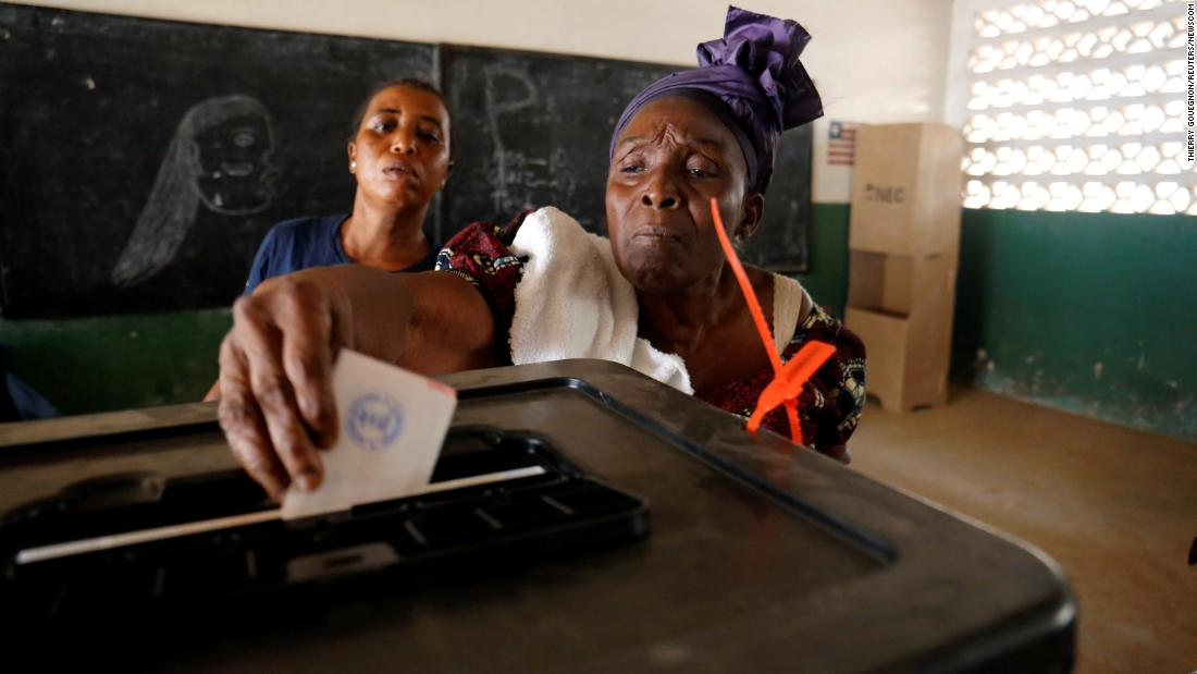 A woman casts her ballot during the presidential election in Monrovia, Liberia, on December 26.