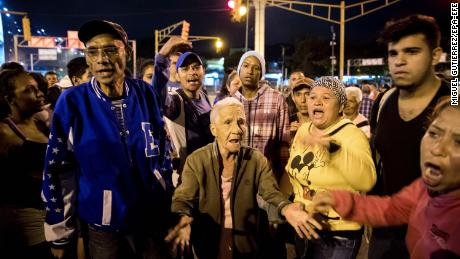 Protesters take to the streets of Caracas, Venezuela, on Wednesday night.  The country has witnessed angry demonstrations over shortages of basic supplies including gas, food and water.