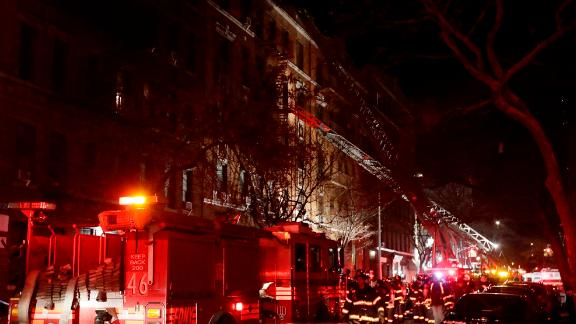 Firefighters respond to a building fire Thursday, December 28, in the Bronx borough of New York.