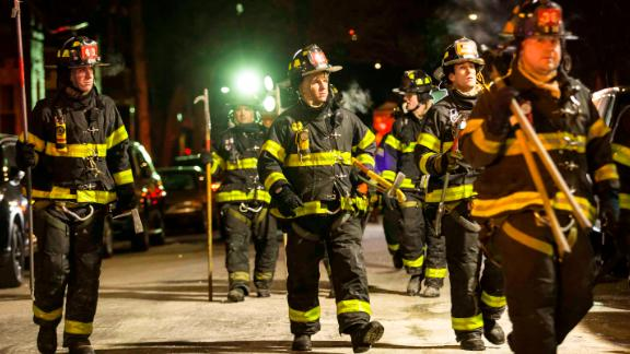 Firefighters leave after putting out the fire.