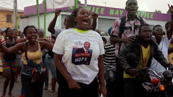 Weah supporters react after the announcement of partial results of the second round of the presidential election, on December 28, 2017 in Monrovia, the Liberian capital.
