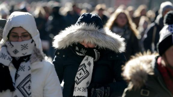 People try to keep warm in New York