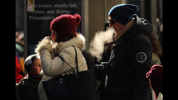 People walk through a frigid New York City on Thursday, December 28.