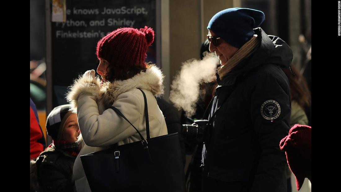 People walk through a frigid New York City on Thursday, December 28.