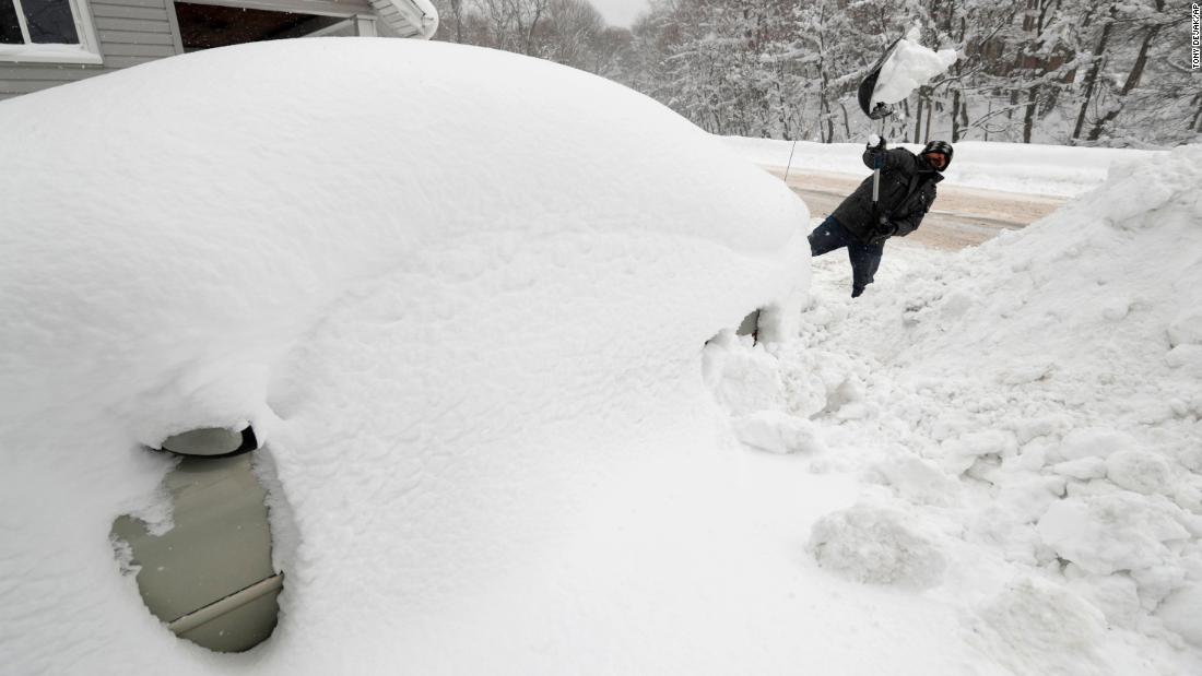 A man digs his car out in his driveway in Erie, Pennsylvania, on December 29.