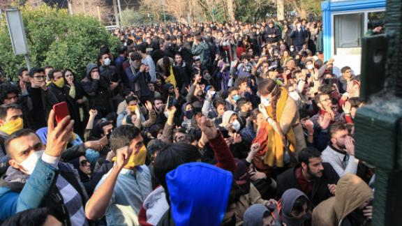 Iranian students protest at the University of Tehran during a demonstration driven by anger over economic problems, in the capital Tehran on December 30, 2017. Students protested in a third day of demonstrations, videos on social media showed, but were outnumbered by counter-demonstrators.  / AFP PHOTO / STR        (Photo credit should read STR/AFP/Getty Images)