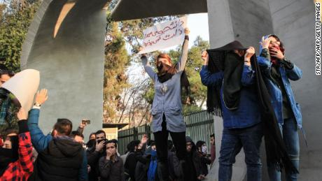 Students protest Saturday at the University of Tehran.