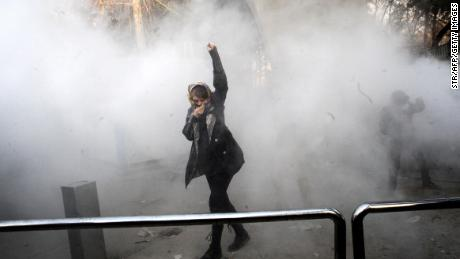 Tear gas is seen during protests at the University of Tehran on December 30.