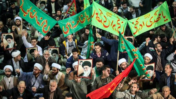 Iranians chant slogans as they march in support of the government in Tehran on Saturday.
