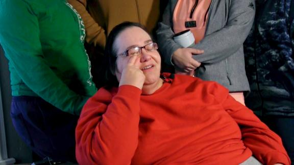 Lisa Finch, surrounded by family members reacts to the killing of her son Andrew Finch.