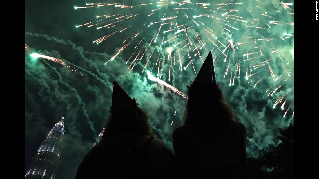 Celebrations take place by the Petronas Twin Towers in Kuala Lumpur, Malaysia.