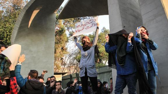 Iranian students protest at the University of Tehran during a demonstration driven by anger over economic problems, in the capital Tehran on December 30, 2017. Students protested in a third day of demonstrations sparked by anger over Iran's economic problems, videos on social media showed, but were outnumbered by counter-demonstrators. / AFP PHOTO / STR        (Photo credit should read STR/AFP/Getty Images)