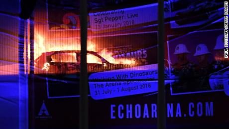 Cars burn during a blaze engulfing vechiles parked at a multi-storey car park near the Echo Arena, at the waterfront in Liverpool on December 31, 2017. 