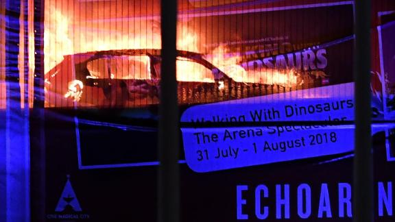 A massive blaze engulfs vehicles parked at a multi-storey car park near the Echo Arena, at the waterfront in Liverpool, England on Sunday afternoon.