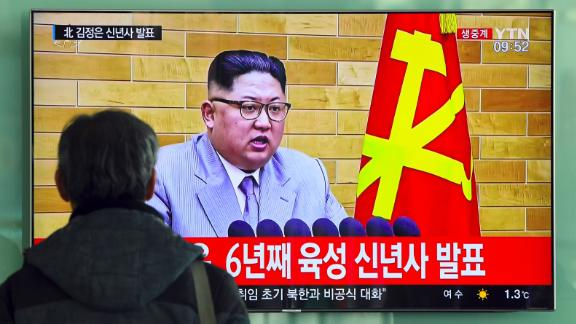 A man watches a television news broadcast showing North Korean leader Kim Jong-Un's New Year's speech, at a railway station in Seoul on January 1, 2018. North Korean leader Kim Jong-Un said he was always within reach of the nuclear button in a defiant New Year message on January 1 after months of escalating tensions over his country's weapons programme.