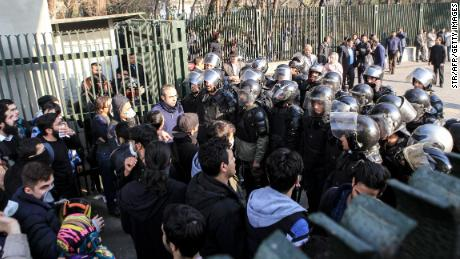 Iranian students scuffle with police at the University of Tehran.