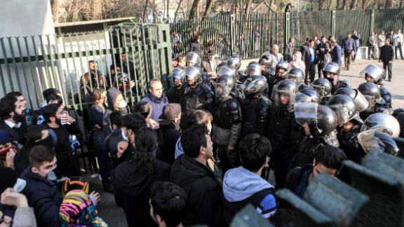 Iranian students scuffle with police at the University of Tehran during a December 30 protest.