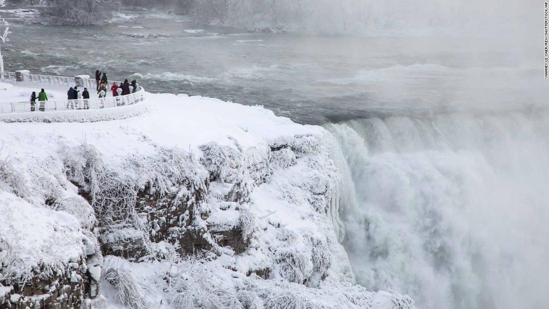 Visitors view Niagara Falls in New York on Sunday, December 31.