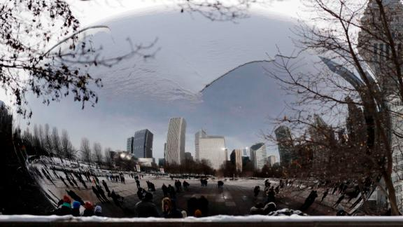 The Cloud Gate sculpture is blanketed with snow in Chicago