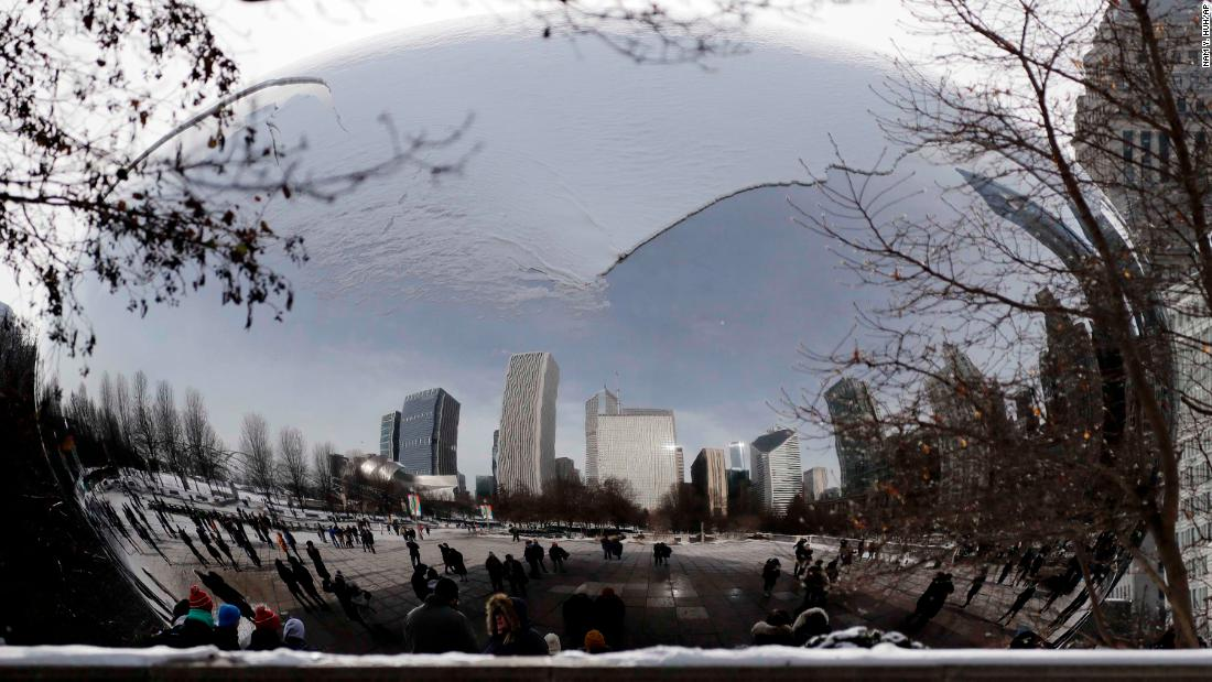 The Cloud Gate sculpture is blanketed with snow in Chicago's Millennium Park on December 31.