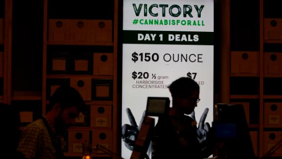 A sign advertises deals at Harborside marijuana dispensary on Monday.