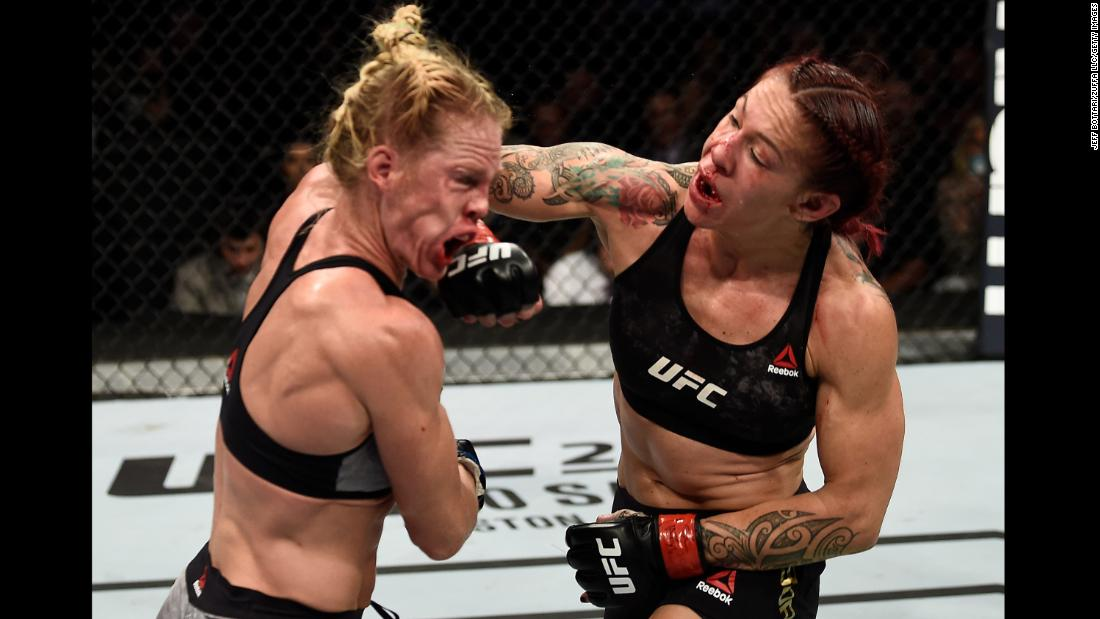 Cris Cyborg punches Holly Holm during their UFC title fight in Las Vegas on Saturday, December 30. Cyborg won a unanimous decision to retain her featherweight championship.
