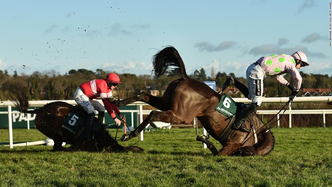 "Jockey Patrick Mullins goes flying off Sharjah, right, as they crash over the final fence of a hurdle race in Dublin, Ireland, on Wednesday, December 27. The fall also took out Real Steel and jockey Paul Townend, left. <a href=""http://www.bbc.com/sport/horse-racing/42496855"" target=""_blank"">According to the BBC,</a> all were reported to be fine following the crash."