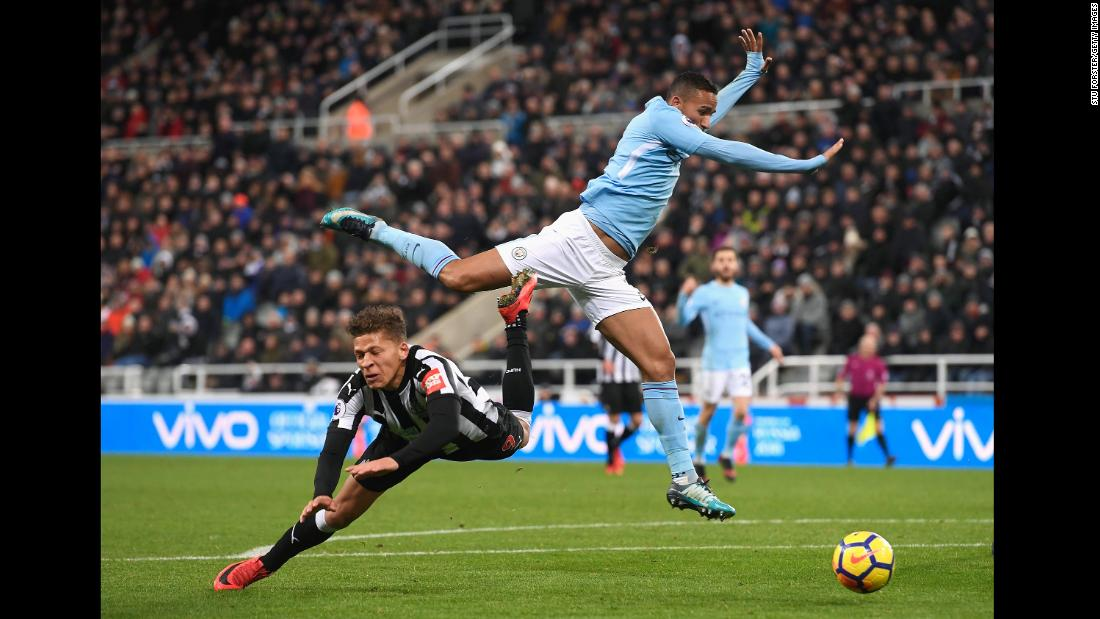 Newcastle striker Dwight Gayle falls to the ground after being challenged by Manchester City fullback Danilo during a Premier League match in Newcastle upon Tyne, England, on Wednesday, December 27. Gayle received a yellow card for diving.