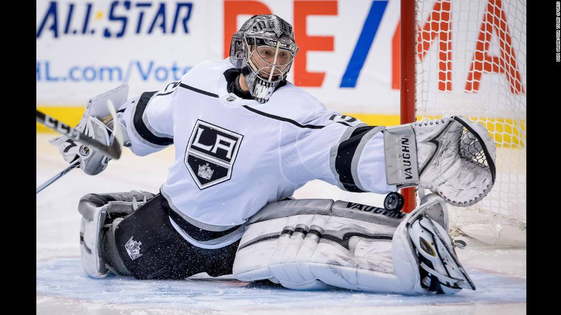 Los Angeles goalie Jonathan Quick does the splits as he tries to make a save during an NHL game in Vancouver, British Columbia, on Saturday, December 30.