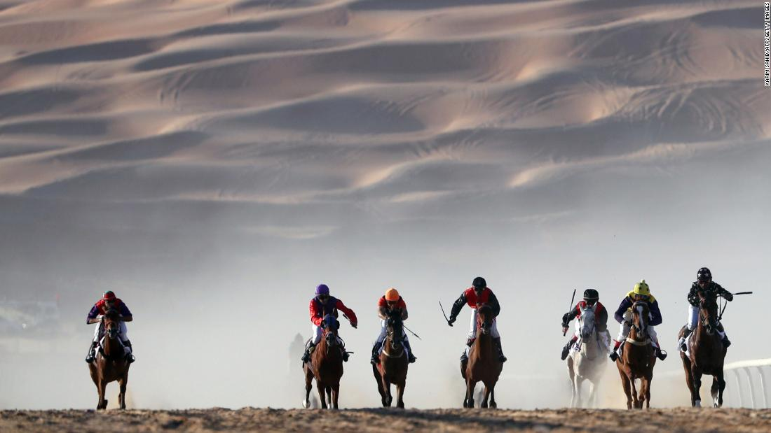 Horses race in the United Arab Emirates' Liwa desert during the Moreeb Dune Festival on Monday, January 1.