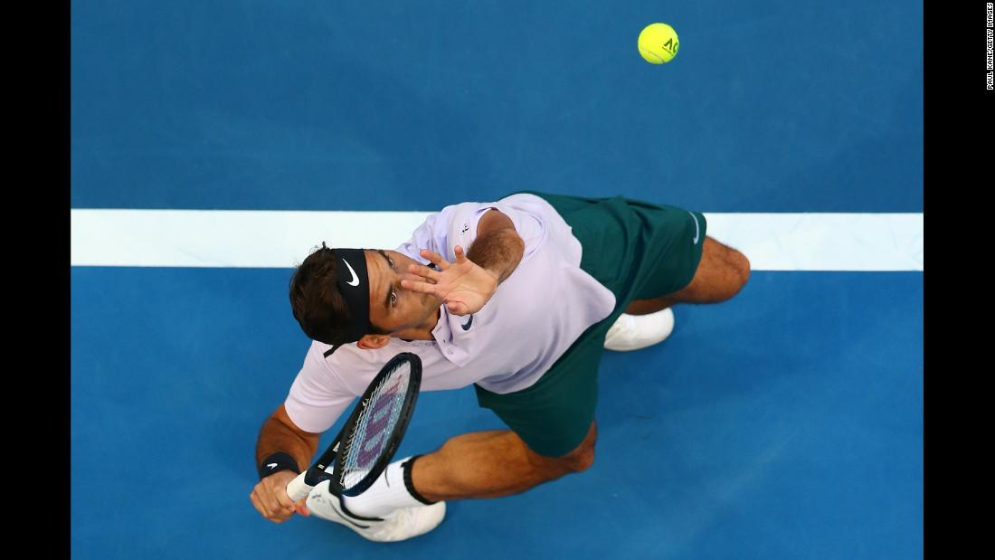 Roger Federer serves to Yuichi Sugita during a Hopman Cup match in Perth, Australia, on Saturday, December 30. Federer and the Swiss team defeated Sugita and the Japanese team 3-0.