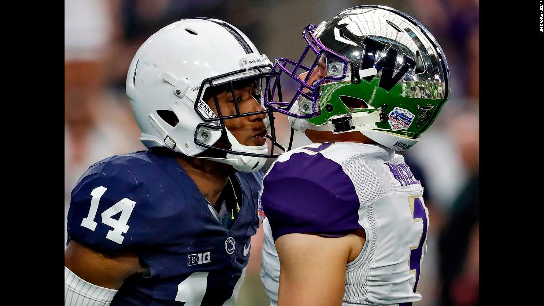 Penn State cornerback Zech McPhearson, left, and Washington quarterback Jake Browning exchange words during the first half of the Fiesta Bowl on Saturday, December 30.