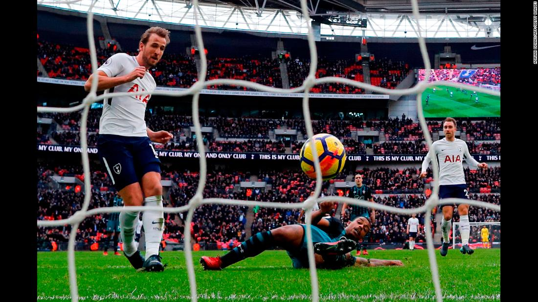 Tottenham striker Harry Kane, left, scores his second of three goals during a Premier League match in London on Tuesday, December 26. Tottenham defeated Southampton 5-3, and Kane broke the league record for most goals scored in a calendar year (39).