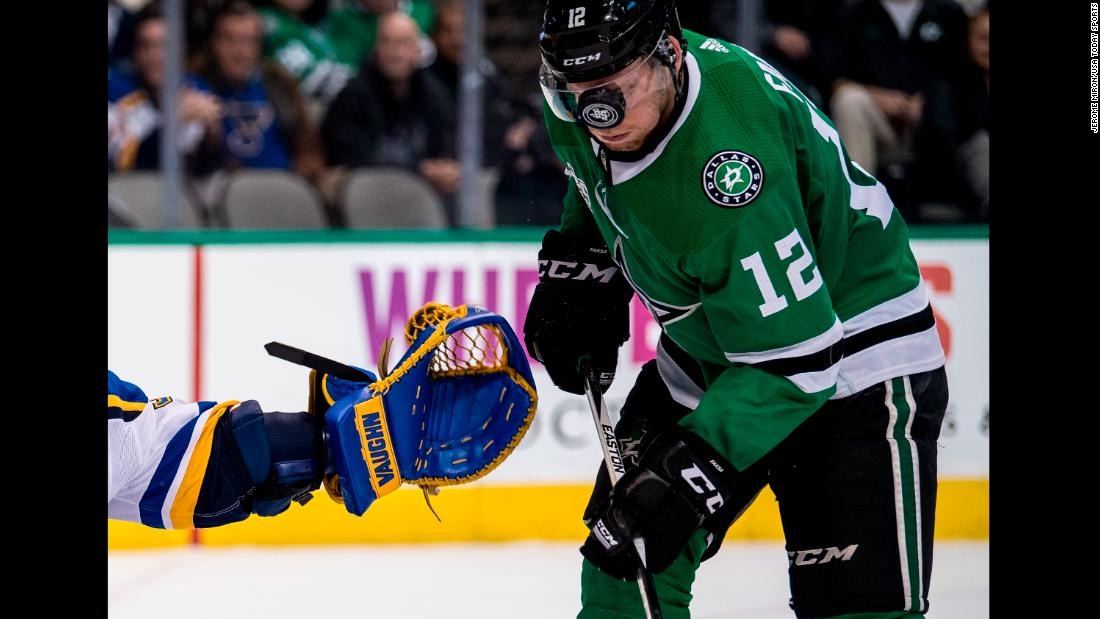 The puck bounces off the visor of Dallas center Radek Faksa during an NHL game on Friday, December 29.