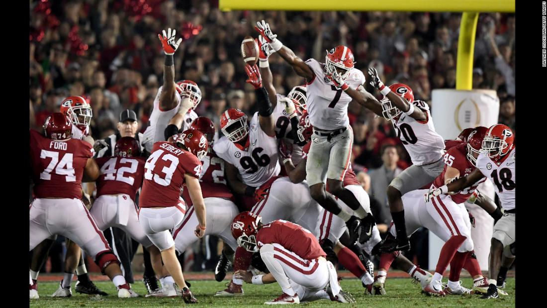 Georgia's Lorenzo Carter (No. 7) blocks an Oklahoma field-goal attempt in the second overtime of the Rose Bowl on Monday, January 1. Georgia scored on the next possession to win 54-48 and advance to the championship game of the College Football Playoff.