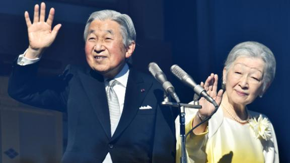 Emperor Akihito and Empress Michiko wave to well-wishers from the balcony of the Imperial Palace in Tokyo on January 2, 2018.