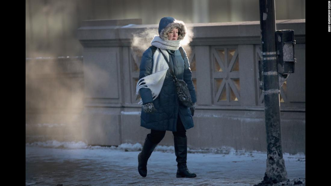 A woman in Chicago walks to work in sub-zero temperatures on Tuesday, January 2.
