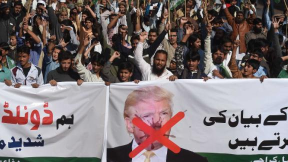 """Activists of the Difa-e-Pakistan Council shout anti-US slogans at a protest in Karachi on January 2, 2018. Pakistan has summoned the US ambassador, an embassy spokesman said January 2, in a rare public rebuke after Donald Trump lashed out at Islamabad with threats to cut aid over """"lies"""" about militancy. / AFP PHOTO / ASIF HASSAN        (Photo credit should read ASIF HASSAN/AFP/Getty Images)"""