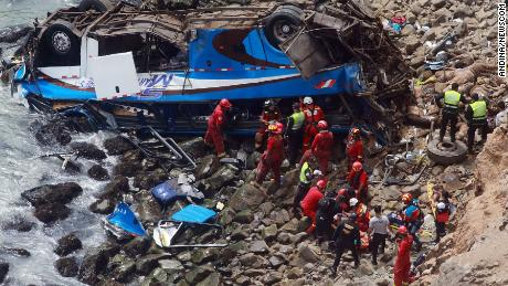 Rescue personnel work at the site of a bus accident north of Lima, capital of Peru, on Tuesday.