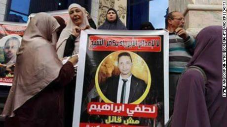 "Protesters gathered outside  a court building in Cairo in 2017 hold a sign saying ""Do not execute the innocents of Kafr el-Sheikh. Lotfy Ibrahim (Khalil) is not a killer."""