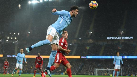 Kyle Walker heads the ball clear in the game against Watford.