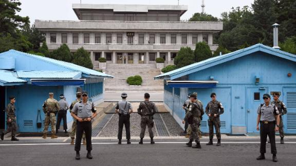 South Korea and US soldiers stand guard during a commemorative ceremony for the 64th anniversary of the signing of the Korean War Armistice Agreement at the truce village of Panmunjom in the Demilitarized Zone (DMZ) dividing the two Koreas on July 27, 2017.The armistice agreement on July 27, 1953 brought three years of active combat in the Korean War to a halt, but the two Koreas are still technically at war as no formal peace treaty was signed. / AFP PHOTO / POOL / JUNG YEON-JE        (Photo credit should read JUNG YEON-JE/AFP/Getty Images)