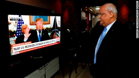 Chief Palestinian negotiator Saeb Erekat watches a speech given by US President Donald Trump on December 6 during which Trump recognized Jerusalem as Israel's capital.