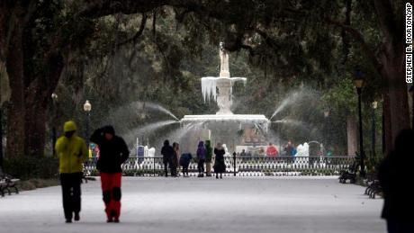 In Savannah, Georgia, an inch of snow had fallen by early afternoon while temperatures remained in the 20s.