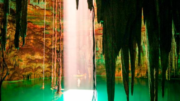Water-filled caverns -- called cenotes -- sustained the Mayan civilization, and were central to its spiritual beliefs. Pictured, Holtun cenote in Chichen Itza.